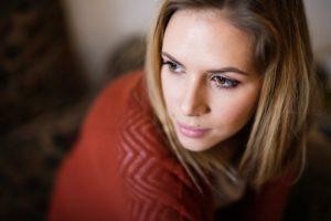 Young woman feeling unhappy.